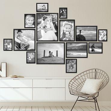 Dekorasi dinding rumah dengan susunan bingkai foto yang cantik.